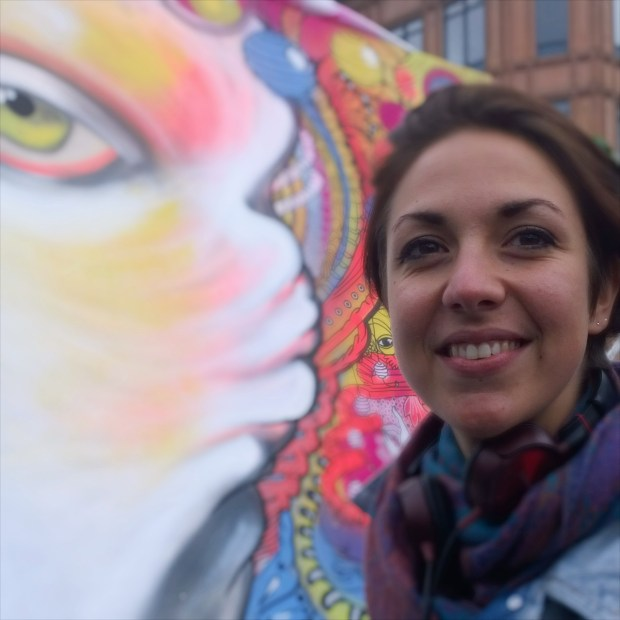 Maggio next to her almost complete painting on the first day