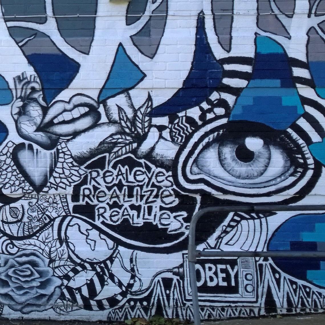 Art by Weardoe on the wall of a nearby building