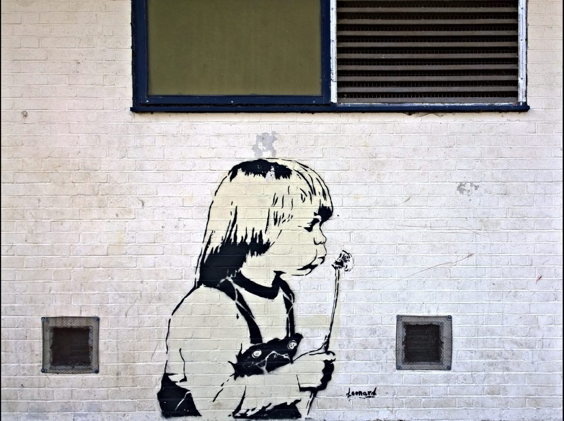 A child blowing a dandelion by 'Leonard'