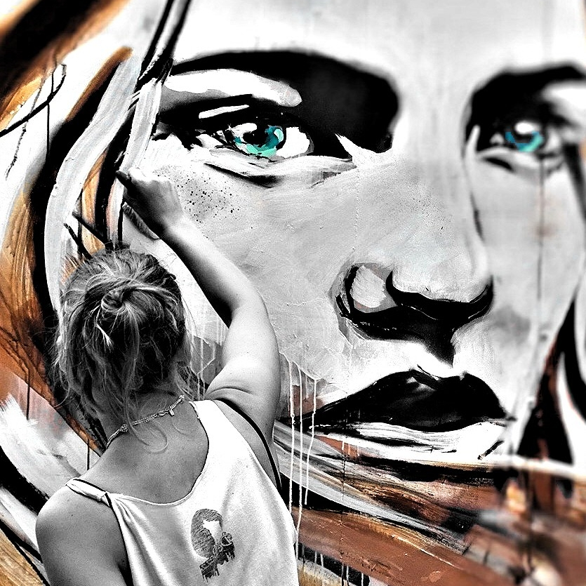 Hannah Adamaszek painting at this years Whitecross Street Party.  Her work is great to photograph, the eyes just draw you in