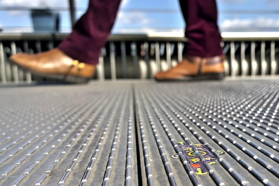 Ben Wilson created hundreds of little pieces of chewing gum art on the millenium bridge.