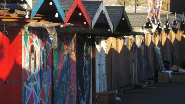 Rows of sheds a lot of them with art