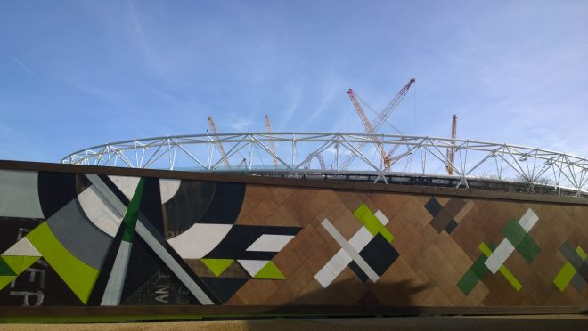 One of the 10 sections of the giant artwork with the Olympic Park looming in the background