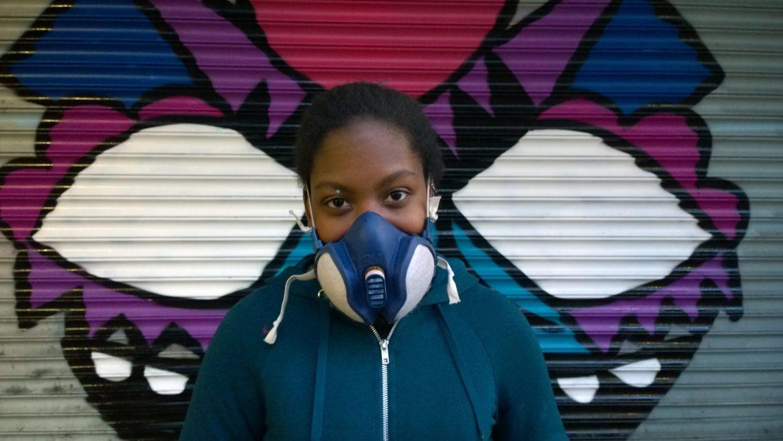 Portrait of street artist Fane taken at the Croydon paint jam in 2015