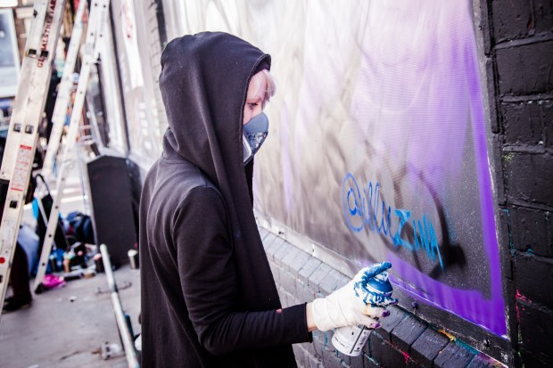 Zina in action on the Shoredtich Art Wall by Rob Wilson Jnr