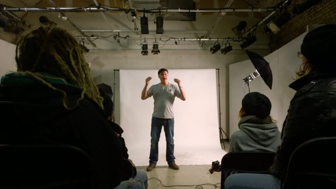 Photographer Lewis Phillips set up in a portable studio to take portraits of the artists during the day