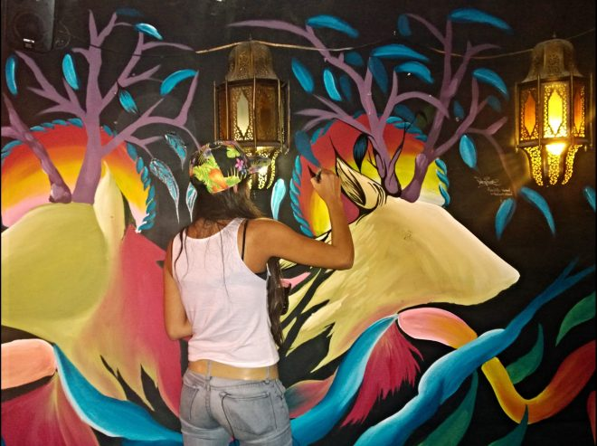 Fio painting her wall in Montys Bar, Brick Lane