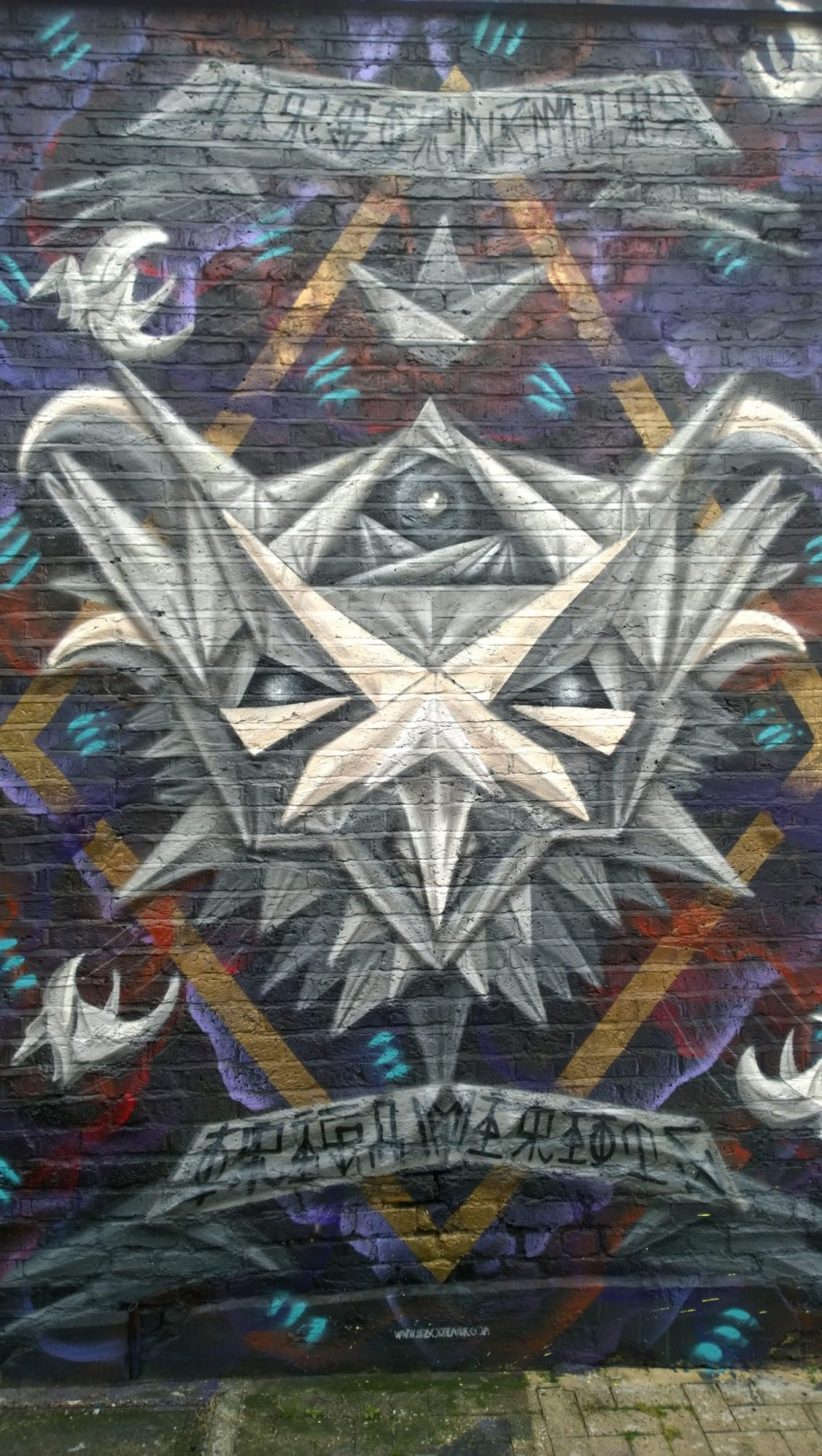Airborne Mark has often painted in Camden and the latest piece in his 'Origami Riots' series can be found here