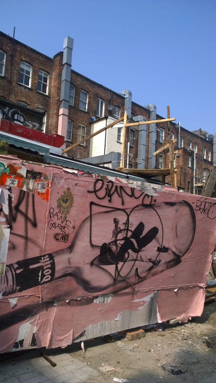The bottle, giant paste up on Hanbury Street