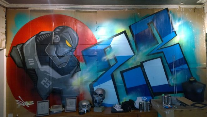 The giant Robot painted on the back wall of the gallery