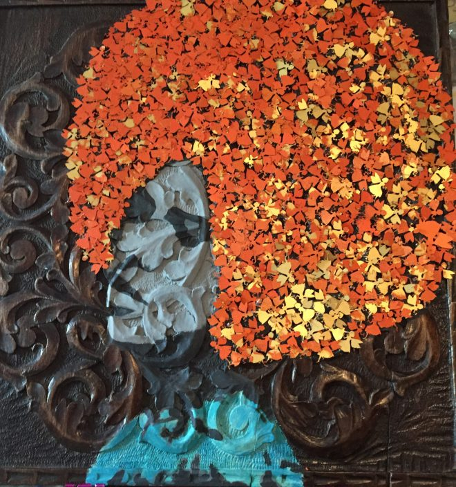 Orange Soul Sister is a modern portrait,  a mixed media piece, Carved Oak, Acrylic paint & tiny fairies cut out and used for the hair then museum framed behind glass.
