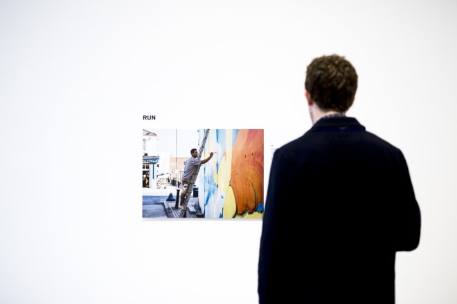 A visitor learns more about RUN, the Italian artist