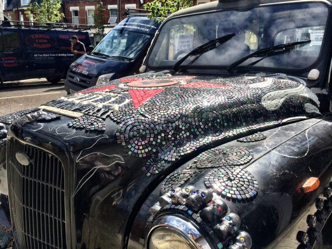 The mosaic adorned taxi by the treatment rooms
