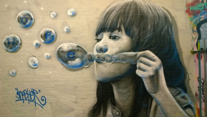 Girl blowing bubbles of hope by Gnasher
