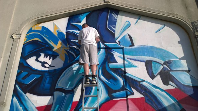 Darkissed Dayze finished up his piece.  He has a graffiti store in the town