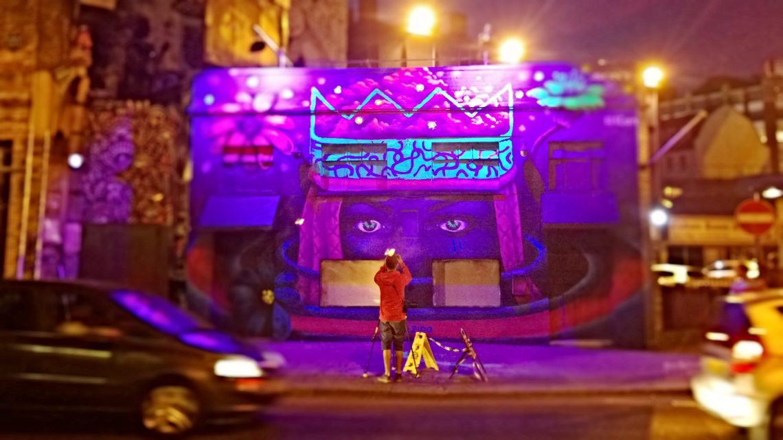 Zina's luminous mural with assistance from Amara Por Dios glowing on a Shoreditch night