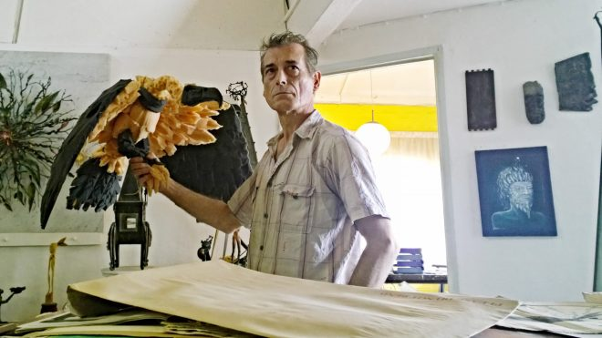 Jonesy holding a vulture made our foam in his workshop
