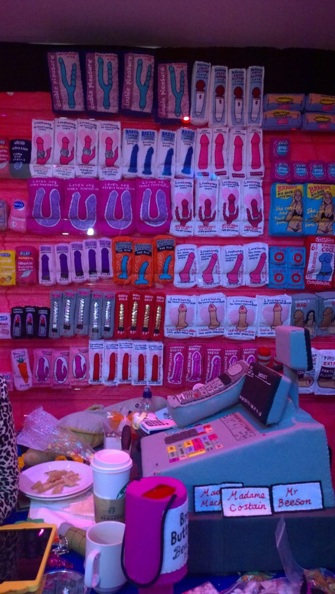 The till and a wall lined with felt goodies