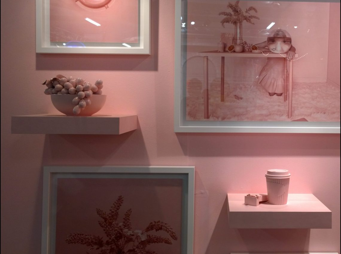 A pink room with pink pictures and other pink stuff