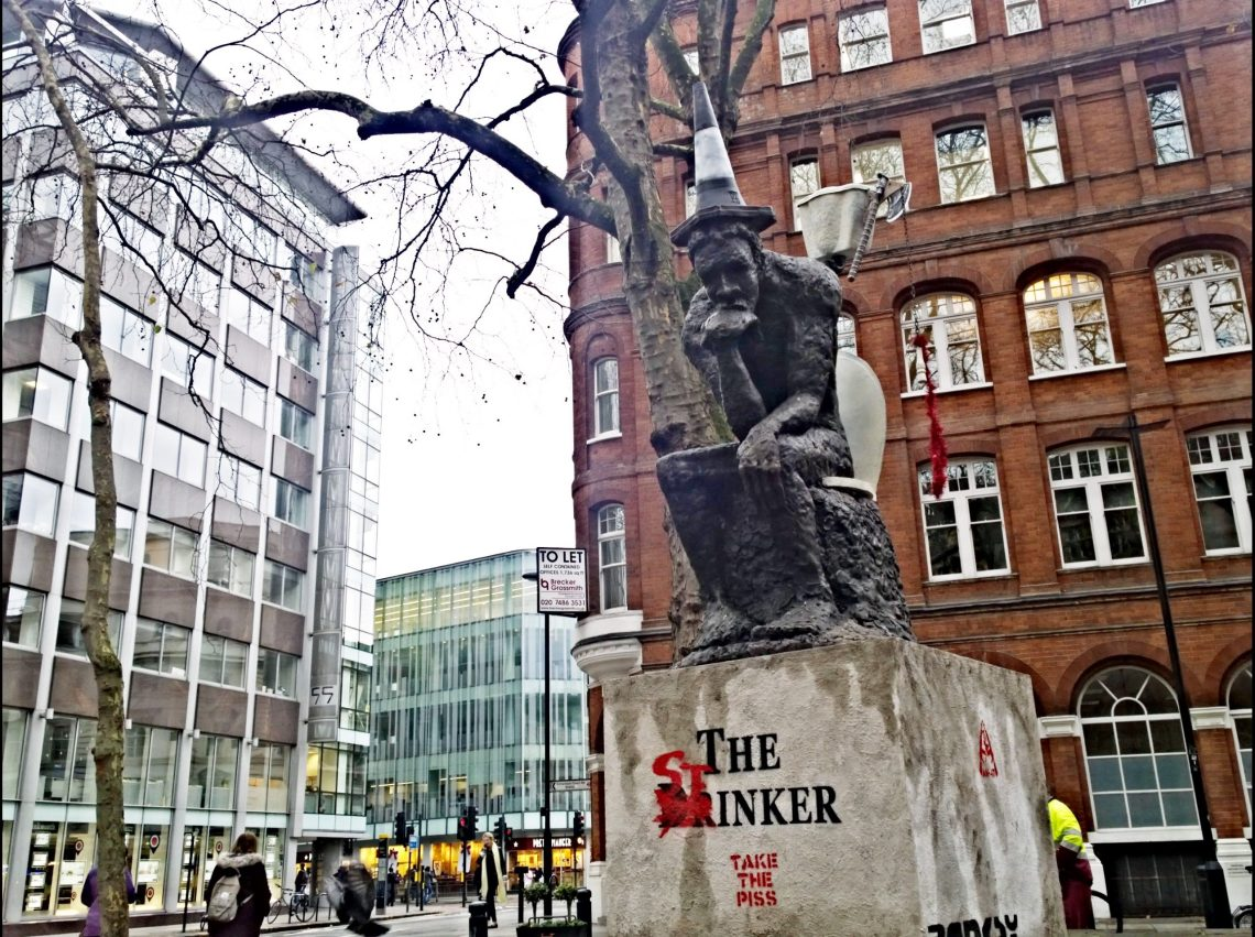 The Drinker statue by Banksy has been defaced by the artist AK47
