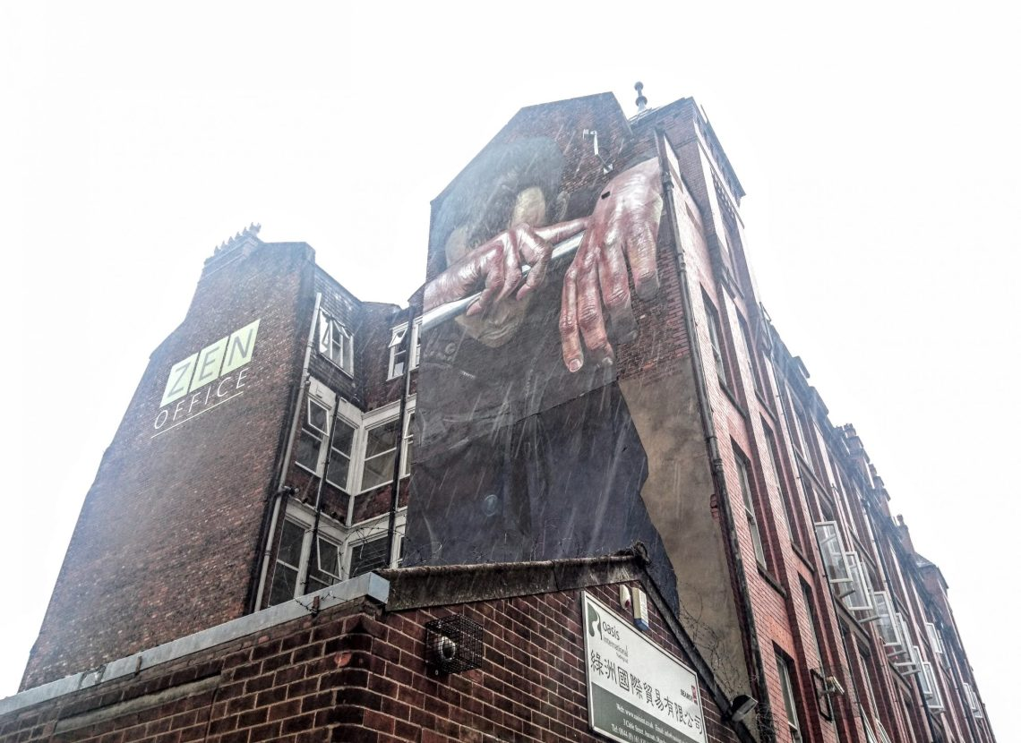 Large mural by Case Maclaim on the side of Swan Buildings in Manchester. Created as part of the Cities of Hope Festival