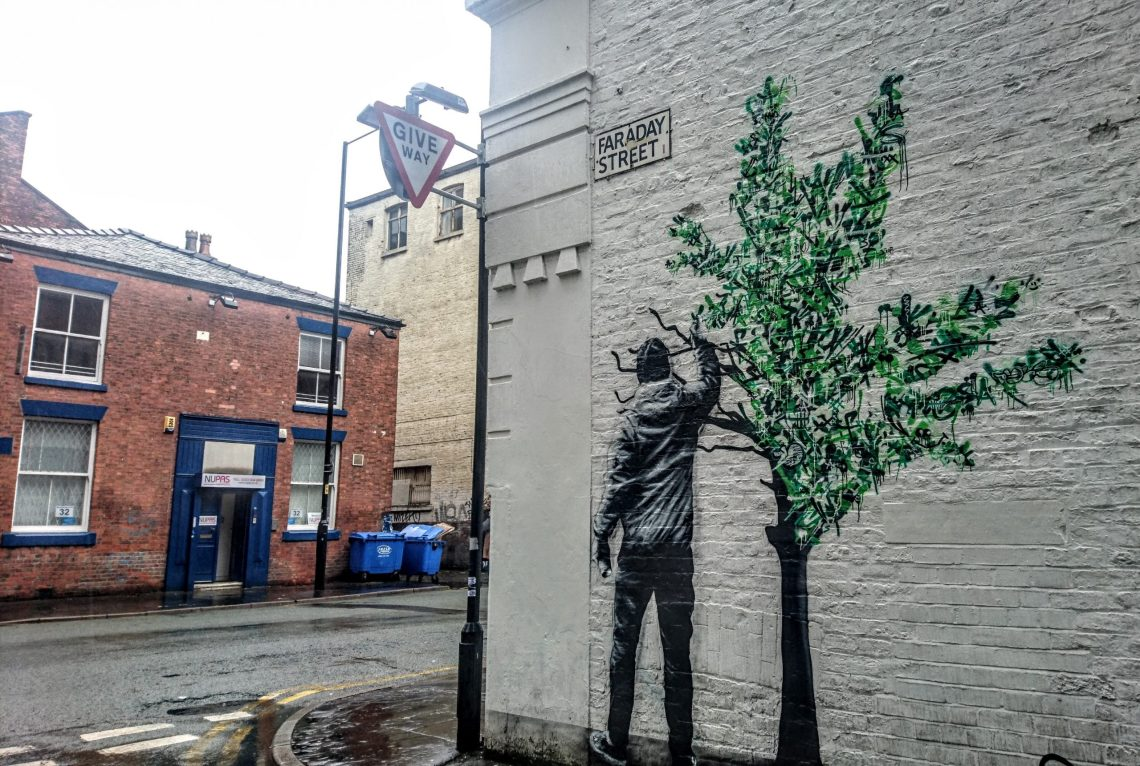 Mural by Martin Whatson on Faraday Street in Manchester. Painted as part of the Cities of Hope festival