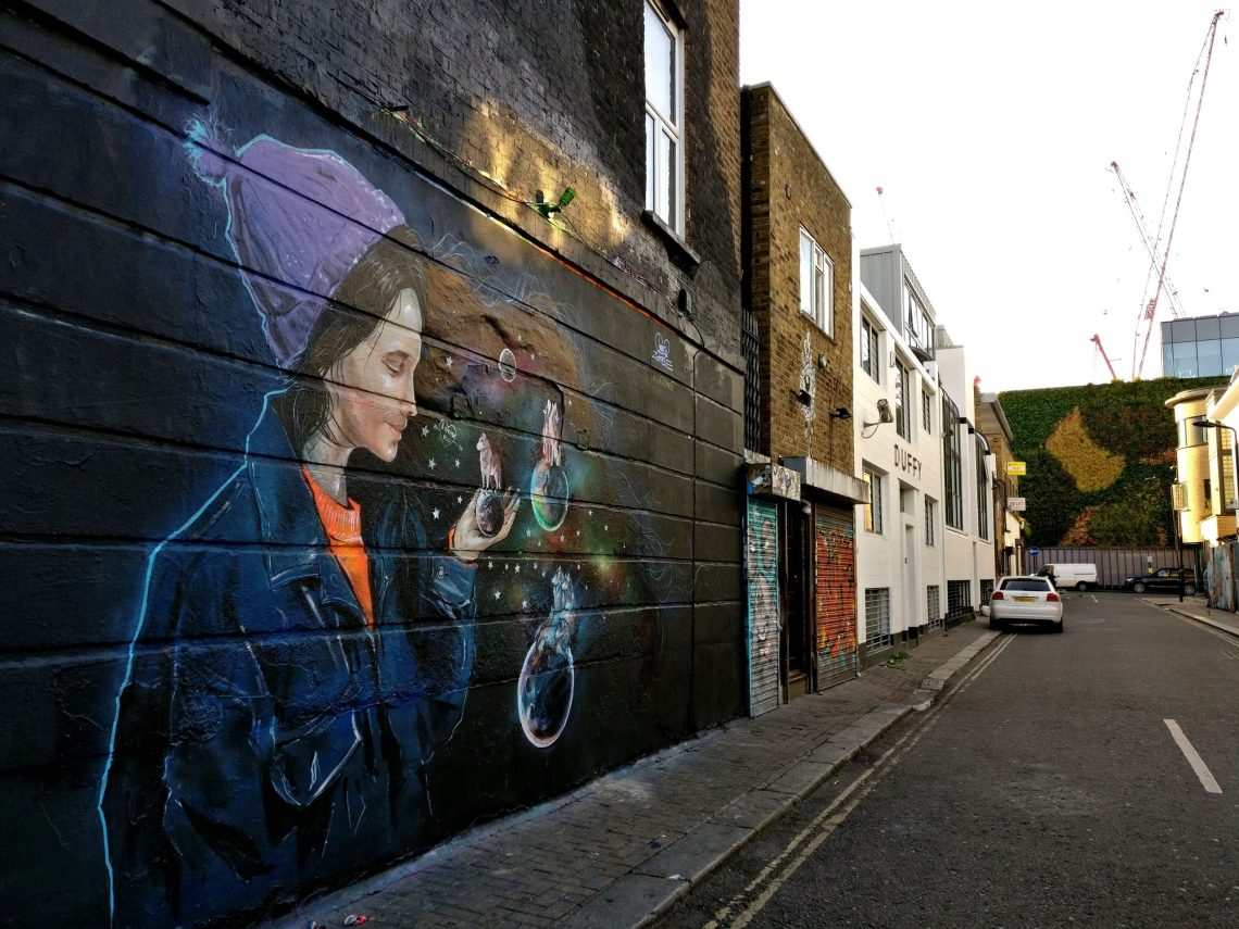 A street art mural by Lora Zombie in Camden which is one of the best places in London to find street art