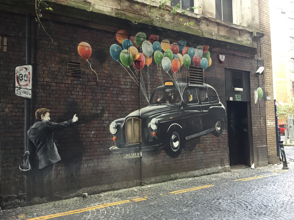 Rogue One taxi mural in Glasgow. He is one of our top artists in Britain