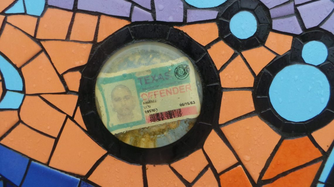 Luis Ramirez prison ID encased in resin at the back of Carrie Reichardt's House