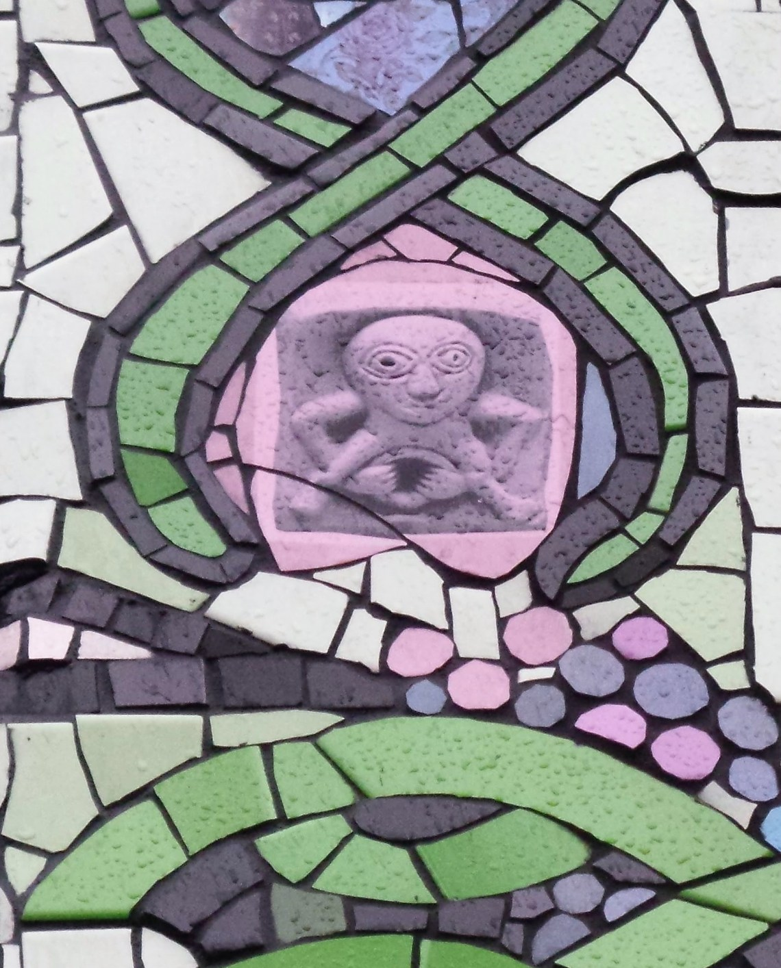 A Sheela Na Gig hidden on the front of the mosaic house