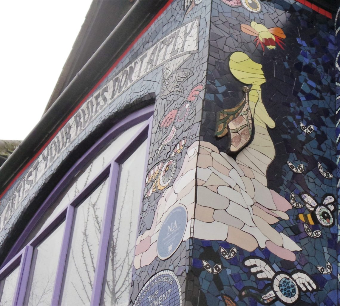 A Bee Fairy mosaic by Stephanie Roberts on the front of the mosaic house