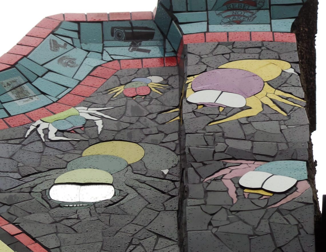 Spacebugs by Philippe Vignal on the front of Carrie Reichardt's mosaic house