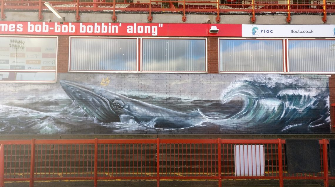 Whale mural inside Craven Park in Hull by the Nomad Clan