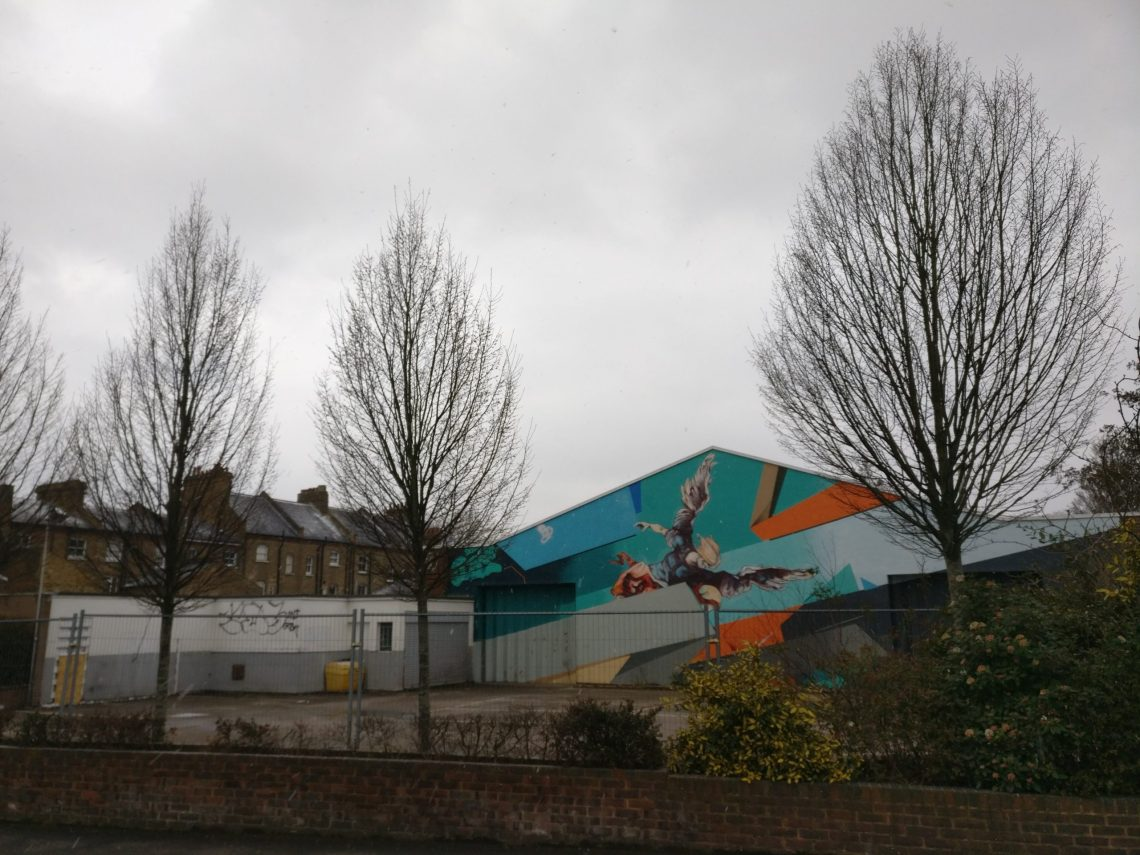 Fall of the Rebel Angels mural on the side of the old Audi garage in Dulwich Village