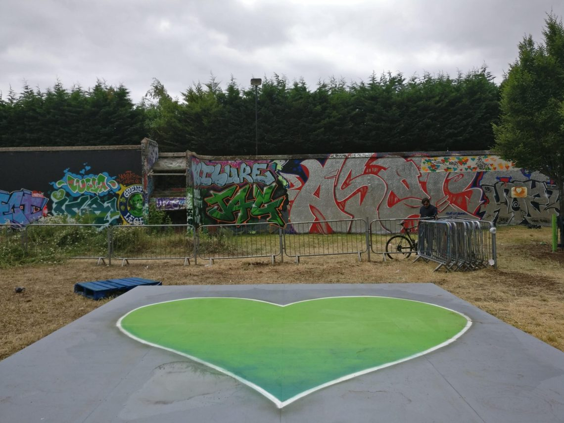 A green heart for grenfell painted at the graffiti jam