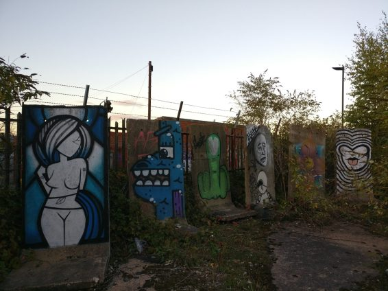 Work from multiple artists in the yard of the tramsheds