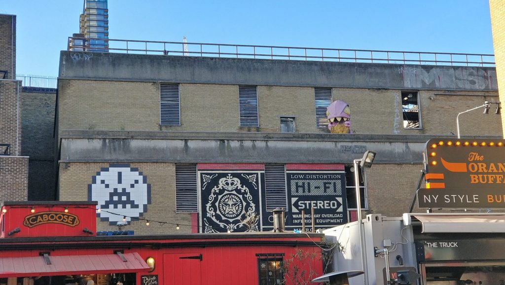 Invader, Shepard Fairey and Ronzo overlooking the Truman Brewery