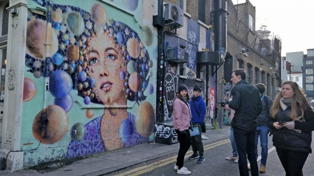 A street art tour looks at a street art mural on Grimsby Street in Shoreditch