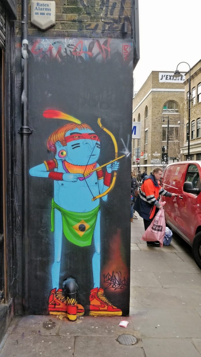 Blue man street art by Cranio on Brick Lane