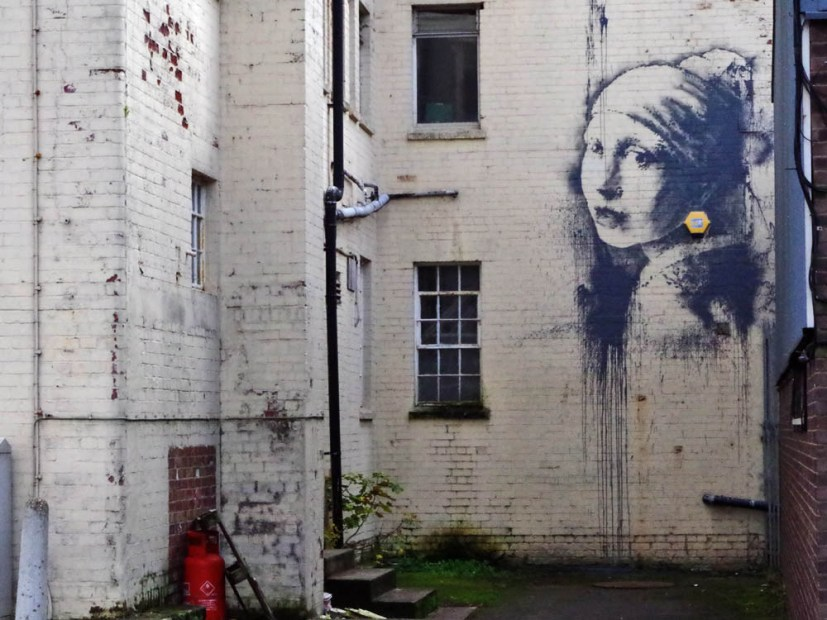 Banksy's the Girl with a Pierced Eardrum in Bristol, UK