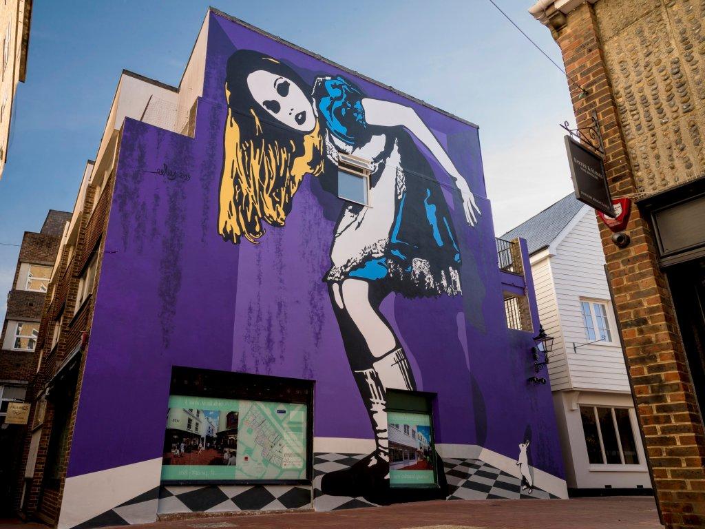 Alice in Wonderland street art by Eelus in Brighton