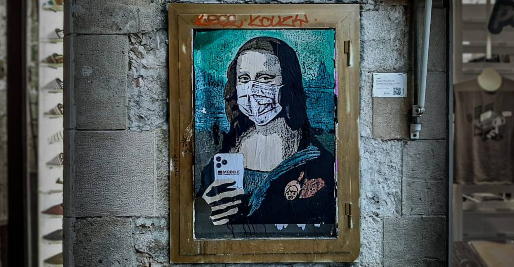 Mobile World Virus street art by TvBoy in Barcelona