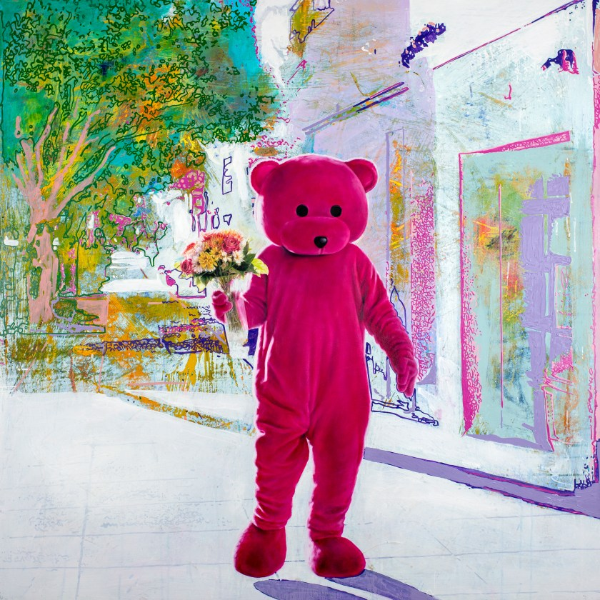 The Pink Bear holding a bunch of flowers