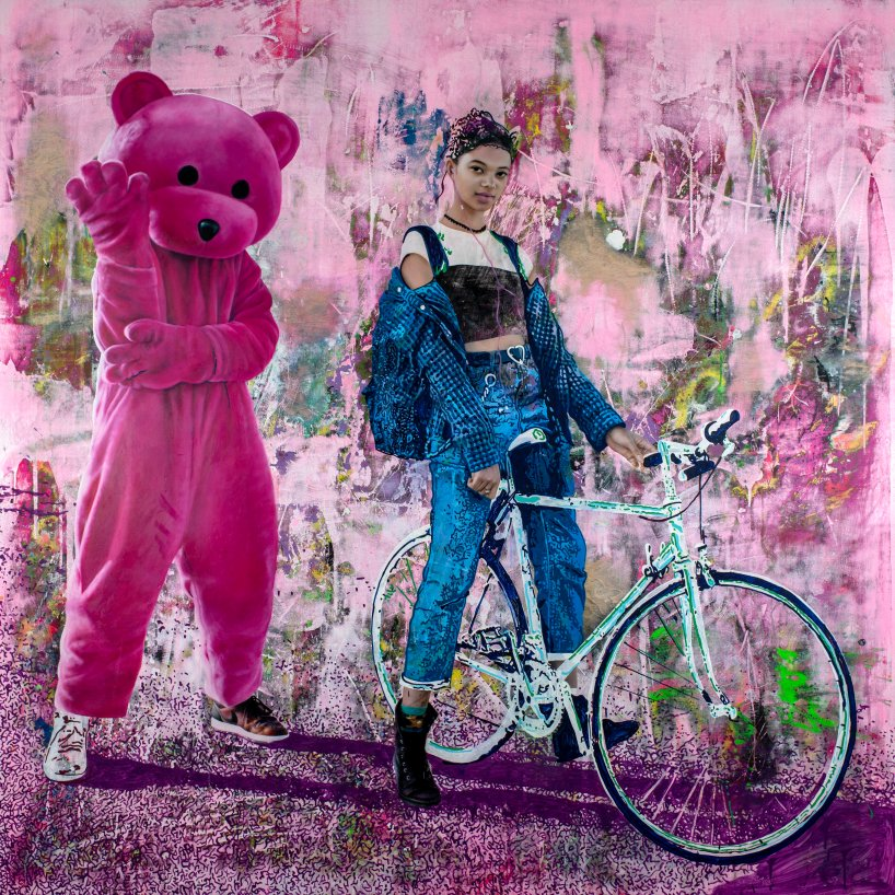 The Pink Bear with a girl on a bike