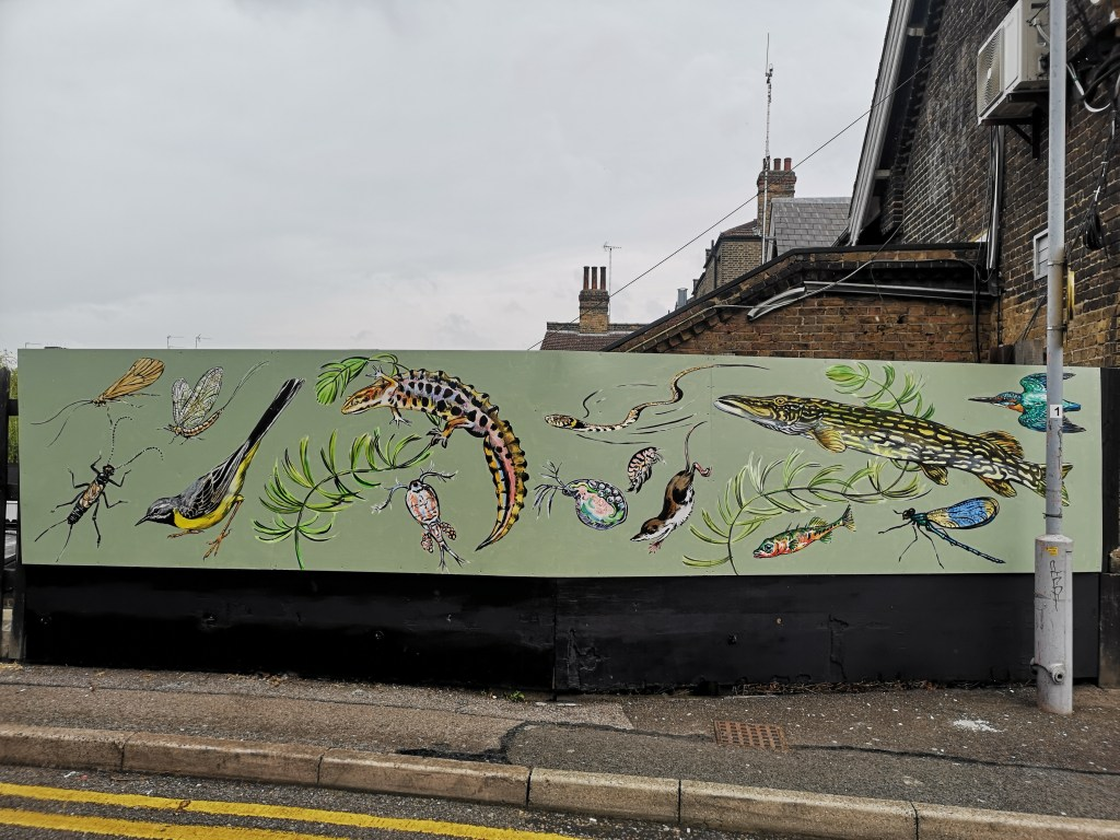 The New River mural by ATM at Palmers Green station