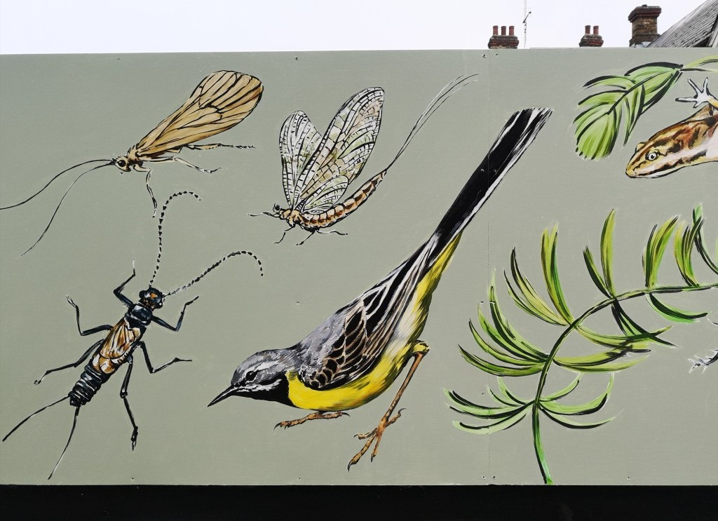 Detail of the New River mural by ATM at Palmers Green station