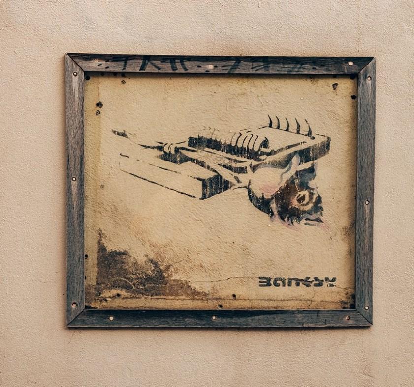 Banksy rose trap street art in Bristol