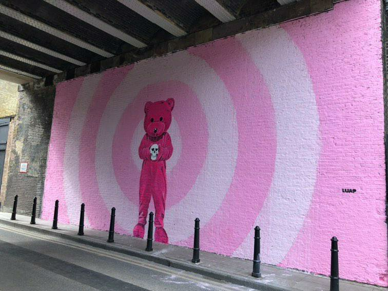 View of the Pink Bear under a bridge in Shoreditch