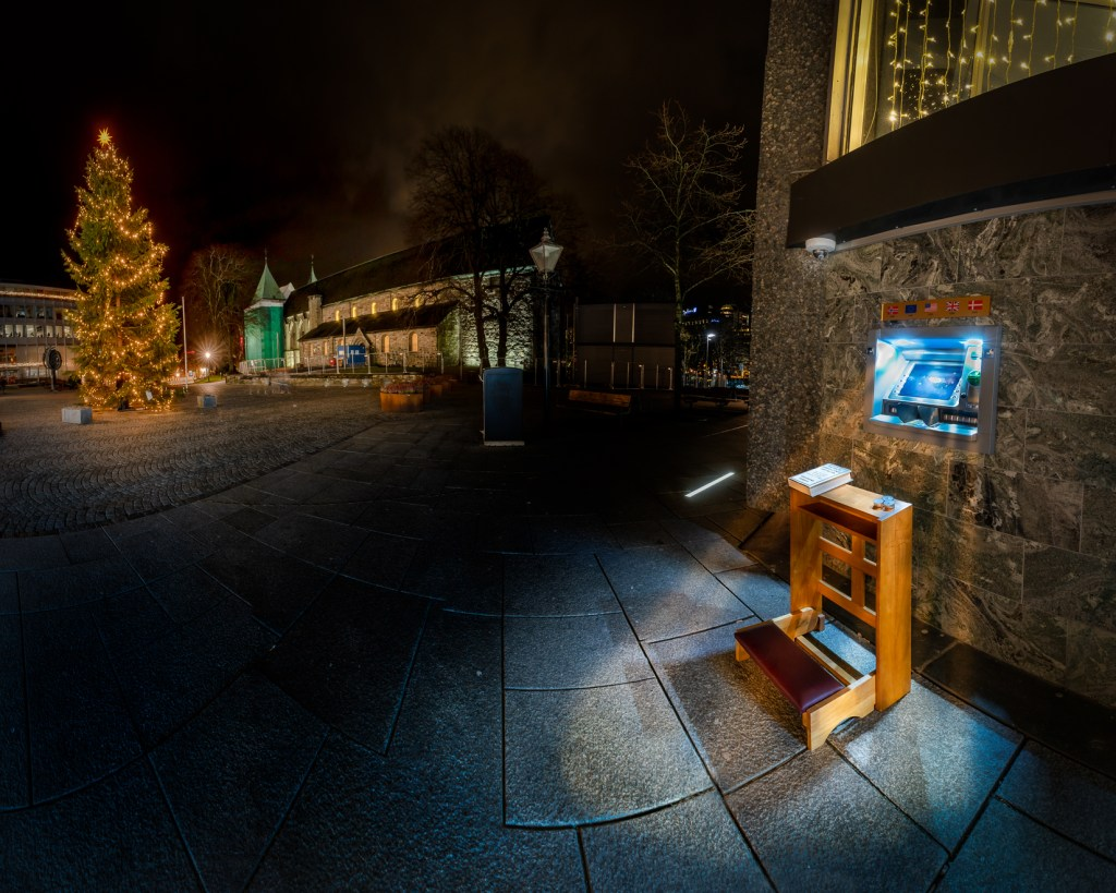 Cash Machine shining a light on a prayer bench in Stavanger, Norway