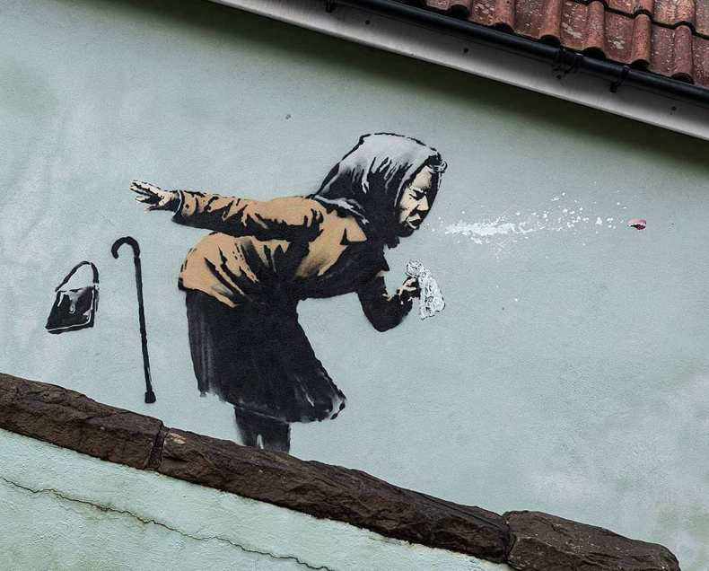 Aachoo by Banksy shows a woman sneezing out her dentures in Totterdown, Bristol